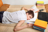 Teenager sleeps after Learning — Stock Photo