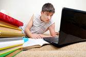 Annoyed Teenager doing Homework — Stock Photo