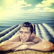 Man on Beach Mattress — Stock Photo