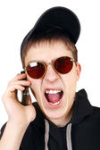 Angry Teenager with Cellphone — Stock Photo