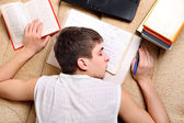 Teenager sleeps on the Books — Stock Photo
