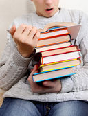 Surprised Teenager reads a Books — Stock Photo
