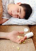Teenager sleeps near the Pills — Stock Photo