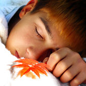 Boy sleeping outdoor — Stock Photo