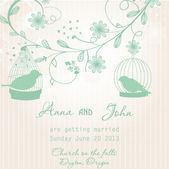 Wedding invitation with two cute birds in cages — Stock Vector
