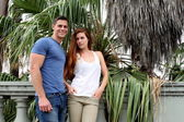 Young Couple Palm Tree — Stockfoto