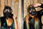 Women with gasmasks — Stock Photo