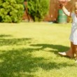 Baby first steps on grass — Vídeo Stock