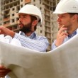 Stock Video: Construction engineers at construction site
