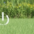 Power icon on grass field — Stock Photo