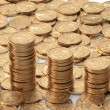Layer of golden coins with diagram of golden coins — Stock Photo #27820561