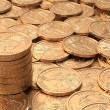Layer of golden coins with stack of coins with DOF — Stock Photo #27826945