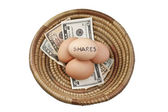 Basket Eggs Shares — Stock Photo