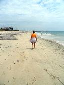 Female beachcomber. — Stock Photo