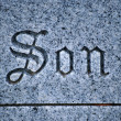 Son tombstone. - Stock Photo