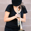 Royalty-Free Stock Photo: Female trumpet player.