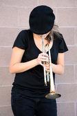 Female trumpet player. — Stock Photo