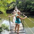 Stock Photo: Female on rope bridge.