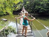 Female on rope bridge. — Stock Photo