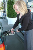 Pumping gas. — Stock Photo