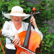 Stock Photo: Mature female cellist.