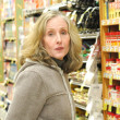 Female in supermarket. — Stock Photo