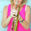 Female trumpet player. — Stock Photo