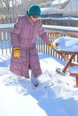 Female shoveling snow. — Foto de Stock