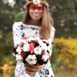 Girl in a wreath and with a bright red make-up — Stock Photo