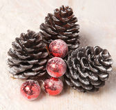 Pine cones and Christmas balls — Stock Photo