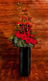 Official classic floral arrangement in a tall glass vase black — Stock Photo