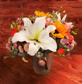 Floral bouquet with lily, sunflower, chrysanthemum, eustoma (lis — Stock Photo