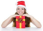 Christmas girl with gifts isolated on white — Stock Photo