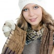 The beautiful girl in mittens - Stock Photo