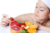 The beautiful woman with fruit — Stock Photo