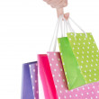 Bright gift bags in hand isolated on white — Stock Photo