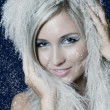 Winter Girl with beautiful make up, silver gloves and snow flake, blue back — Stock Photo