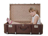 The little girl in an old suitcase isolated — Stock Photo