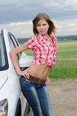 The beautiful girl stands near to white car — Stock fotografie