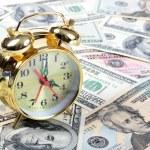 Alarm clock for dollar banknotes — Stock Photo #13808541