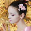 The beautiful girl with a make-up of the Japanese - Stock Photo