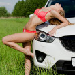 Royalty-Free Stock Photo: Sexual girl in bikini with car
