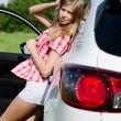 Beautiful girl stands near car — Stock fotografie