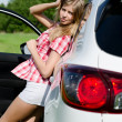 Beautiful girl stands near car — Stok fotoğraf