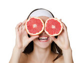 The beautiful woman with grapefruit isolated — Stock Photo