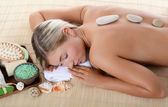 Spa Woman . Stone Massage — Stock Photo
