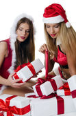 The Christmas girls with boxes of gifts isolated — Stock Photo