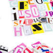 The letters which have been cut out from newspapers — Stock Photo #13930110