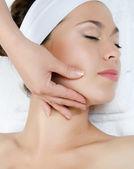 Facial massage to the woman closeup — Stock Photo