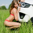 Sexual girl in bikini with car — Foto Stock